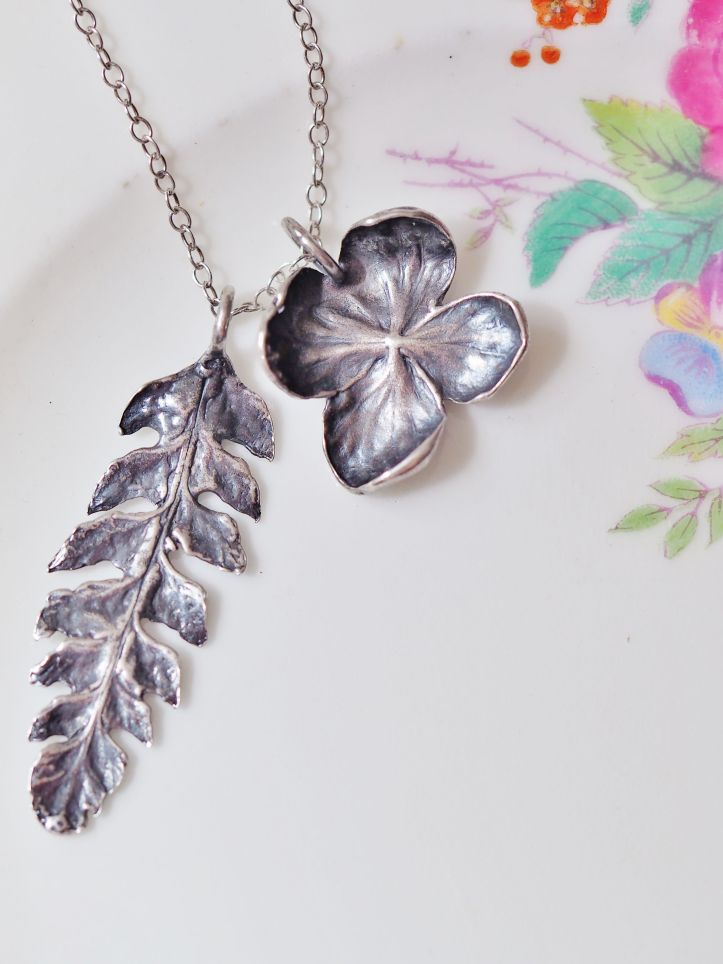 Handmade nature inspired jewellery. Fern and hydrangea flower in darkened vintage silver