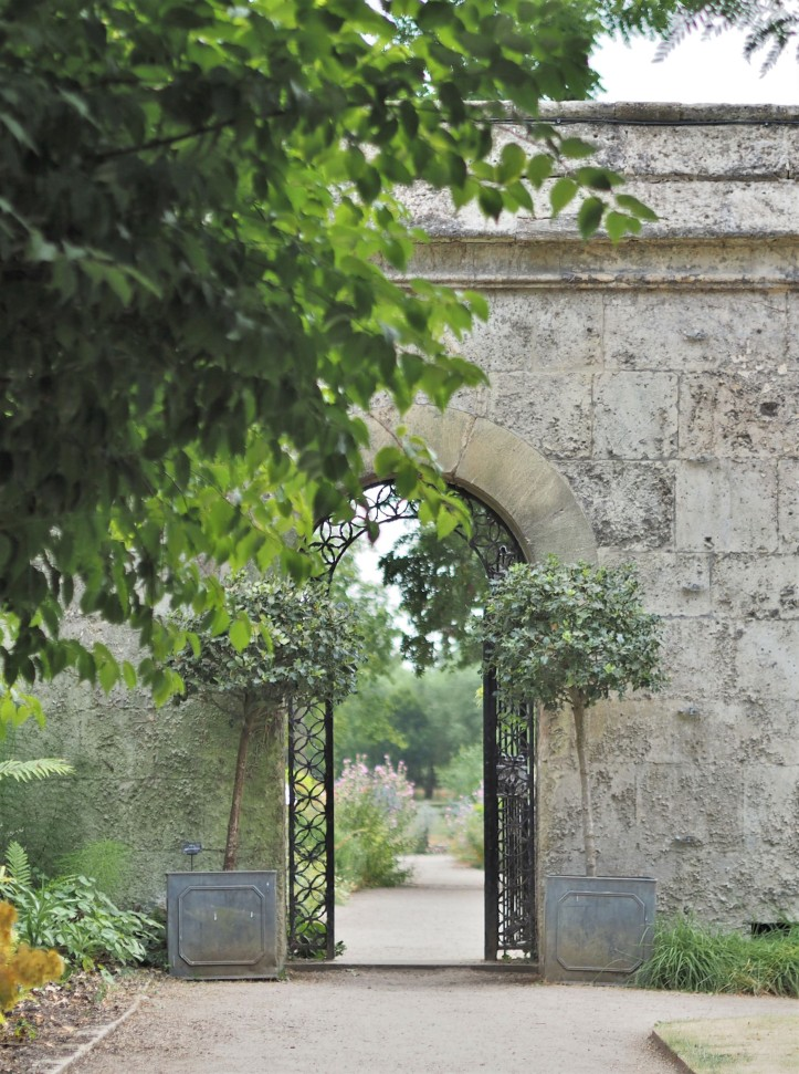 Stone archway and gate to gardens at Oxford Botanic Garden