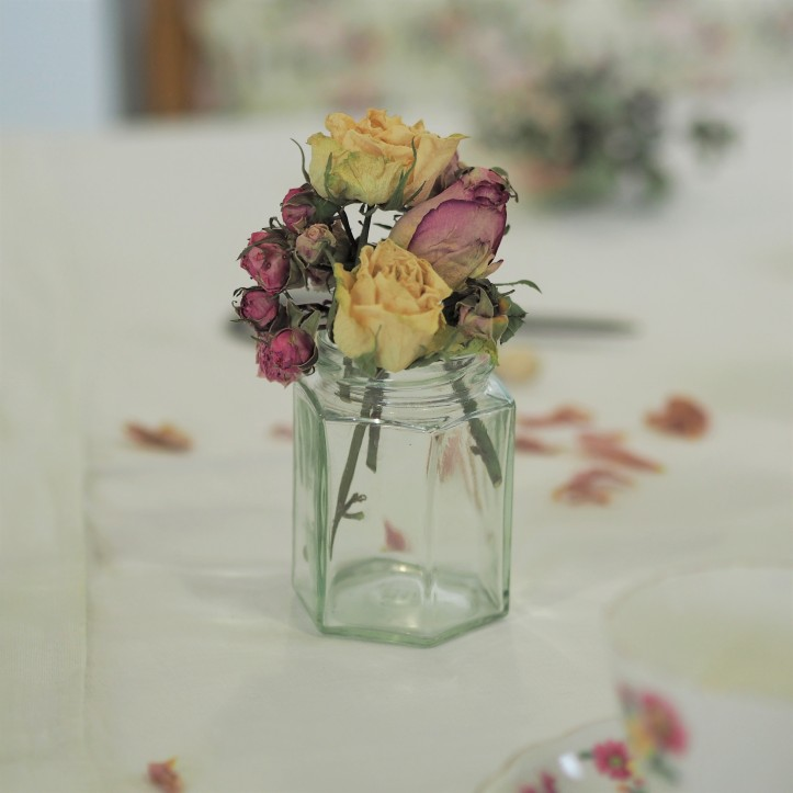 Dried roses posy in glass jar
