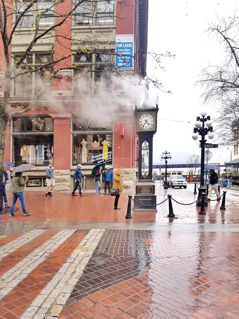 Reflections on pavement from rainy day. Gas Town Steam Clock. Vancouver, British Columbia, Vancouver