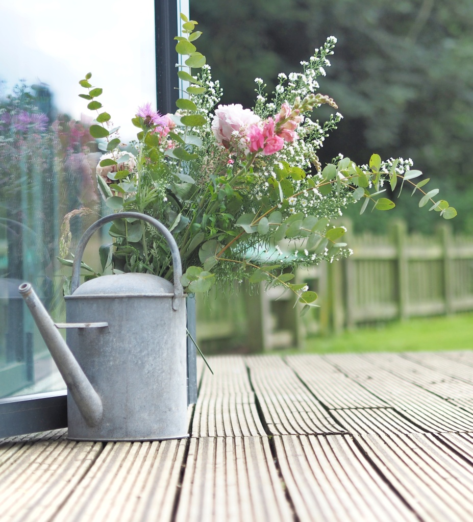 Watering Can filled with Pink flowers